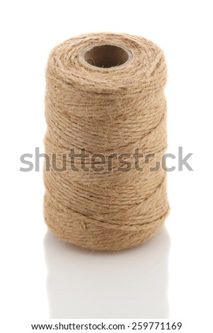 Roll of twine cord on a white background isolate - stock photo