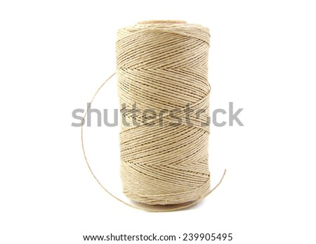 Roll of twine cord on white background - stock photo