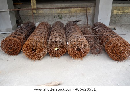 Roll of wire mesh steel pattern on site work, Roll of wire mesh steel lack of maintenance and rust. - stock photo
