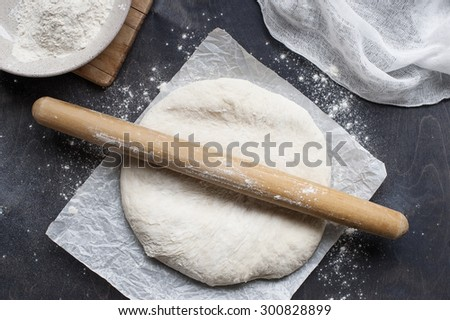 Roll out dough on table - stock photo