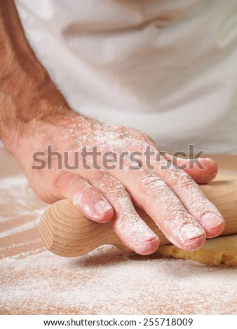 Roll out pastry to round. Making Apple Pie Tart Series. - stock photo