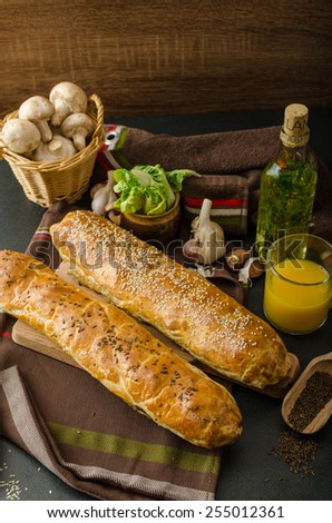 Roll out puff pastry stuffed with mushrooms, cheese and ham - stock photo