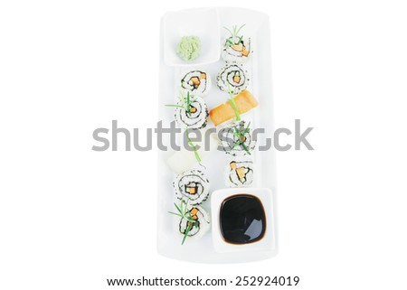 Roll with Cucumber , Cream Cheese with raw Tuna and Salmon inside. on long white plate . Isolated over white background . Japanese traditional Cuisine - stock photo