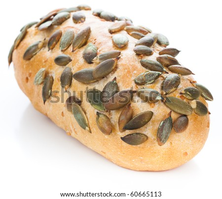 Roll with pumpkin seeds - stock photo