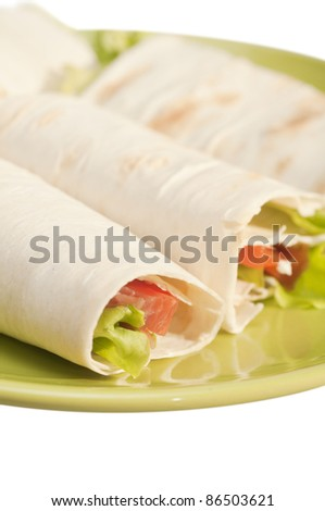 Roll with salmon and salad - stock photo