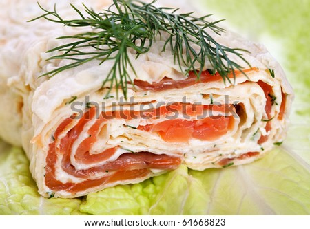 Roll with smoked salmon, cream cheese and dill - stock photo
