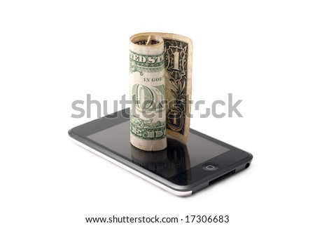 Rolled banknote on a music player - stock photo