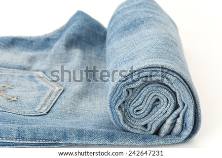 rolled blue jeans texture or detail - stock photo
