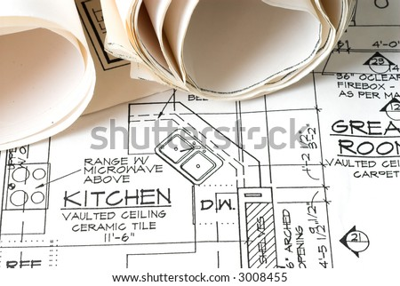Rolled Blue Prints on House Plans - stock photo