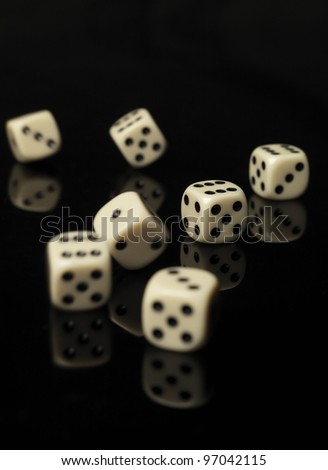 Rolled dices on black background - stock photo
