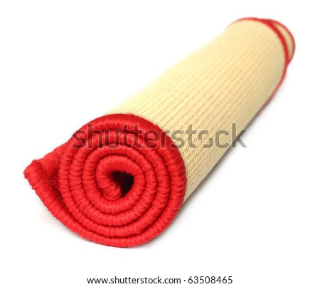 Rolled door mat over white background - stock photo