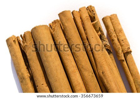 Rolled dry cinnamon isolated on a white background