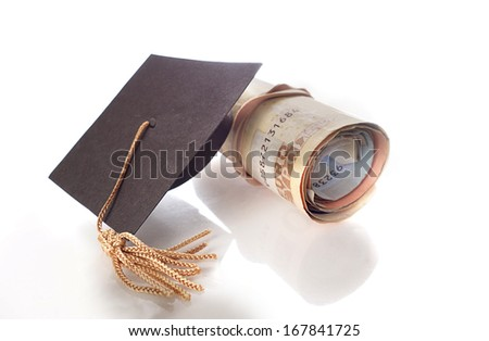 Rolled Euro notes and a mini graduation cap                                - stock photo