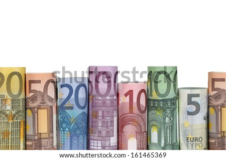 Rolled Euro notes in a row, isolated on a white background
