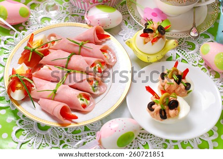 rolled ham stuffed with cheese and vegetables ,eggs as appetizer for easter breakfast - stock photo