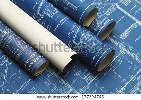 Rolled House Blueprints and Construction Plans. - stock photo
