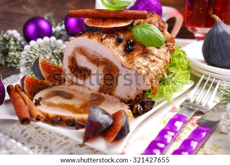 rolled loin of pork stuffed with dried figs for christmas dinner  - stock photo