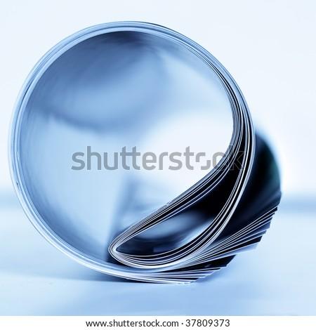 Rolled magazine close-up. Shallow DOF! - stock photo