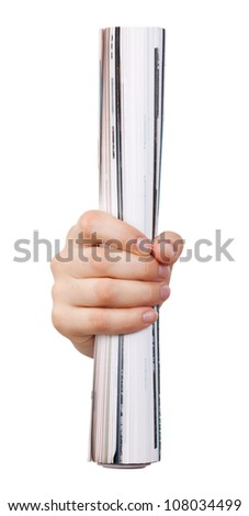 Rolled magazine in the hand of a man - stock photo