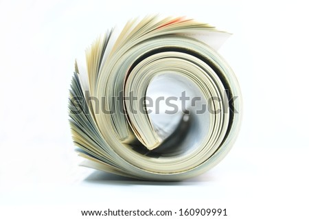 Rolled magazine on white background - stock photo