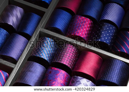 Rolled neckties on display. Assorted man ties at store