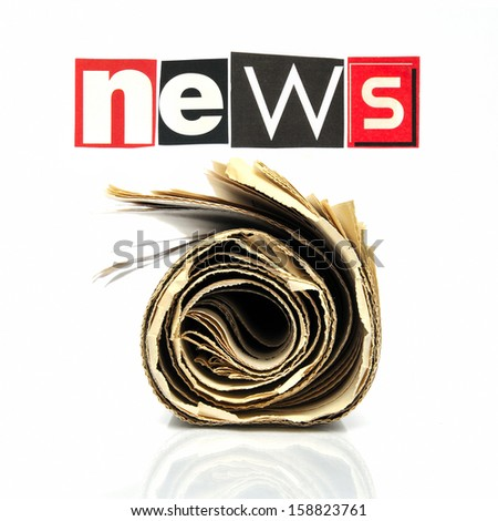 Rolled newspaper below the lettering news - stock photo
