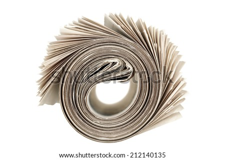 rolled newspaper isolated on white - stock photo
