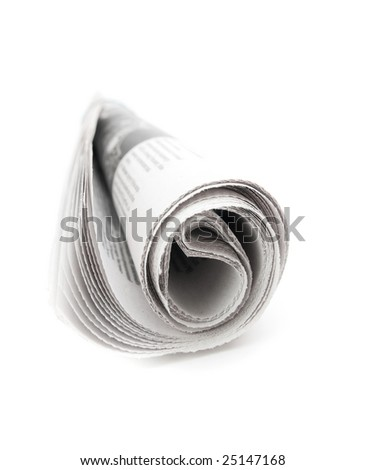 Rolled newspaper on white background - stock photo