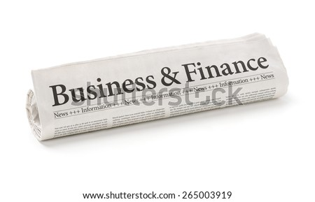 Rolled newspaper with the headline Business and Finance - stock photo