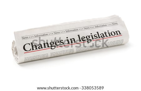 Rolled newspaper with the headline Changes in legislation - stock photo
