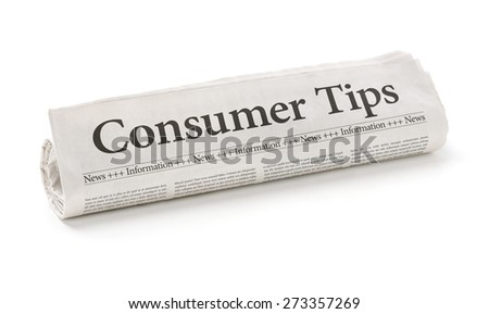 Rolled newspaper with the headline Consumer Tips - stock photo