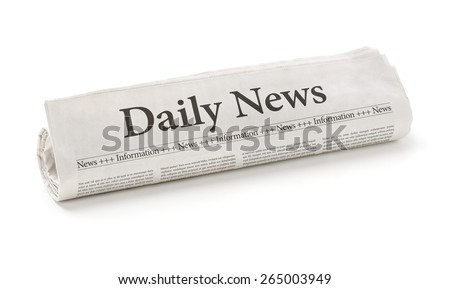 Rolled newspaper with the headline Daily News - stock photo