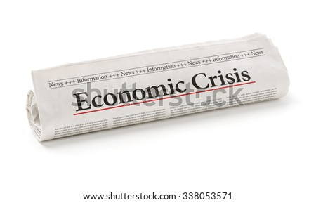 Rolled newspaper with the headline Economic Crisis - stock photo