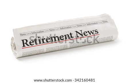 Rolled newspaper with the headline Retirement News - stock photo