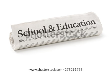 Rolled newspaper with the headline School and Education - stock photo