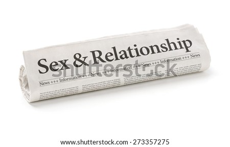 Rolled newspaper with the headline Sex and Relationship - stock photo