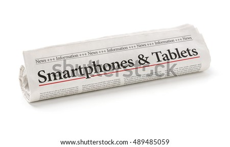 Rolled newspaper with the headline Smartphones and Tablets