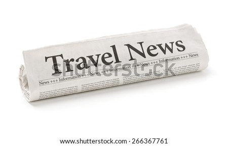 Rolled newspaper with the headline Travel News - stock photo