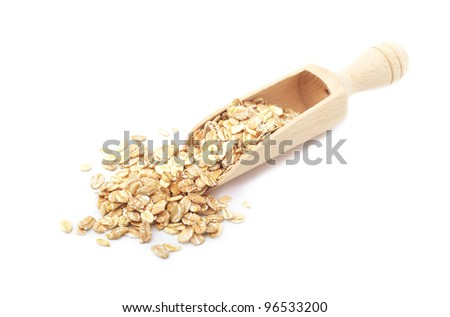 Rolled oatmeal in a scoop - stock photo
