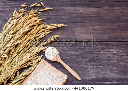 Rolled oats and oat ears of grain on a wooden table.ears of wheat on the table. top view with copy space