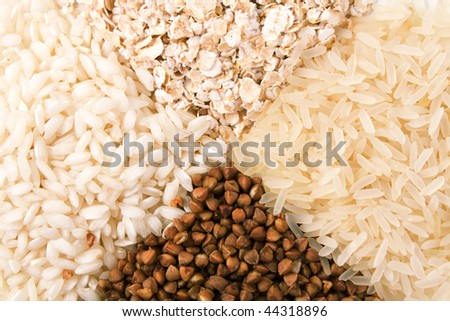 Rolled oats, buckwheat and rice groats background