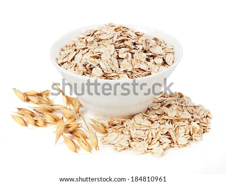 Rolled oats in a plate isolated on white background  - stock photo