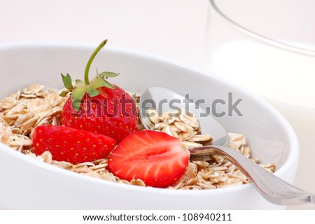 Rolled oats with strawberries and glass of milk.Healthy, dieting concept.Whole foods.