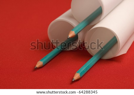 Rolled papers and three pencils - stock photo