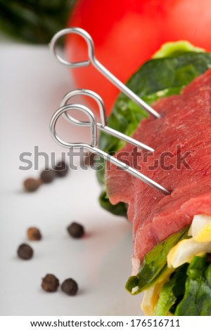 rolled raw veal cutlets and assorted ingredients  - stock photo
