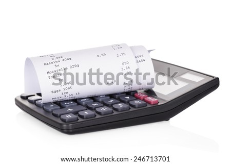 Rolled Receipt On Calculator Over White Background - stock photo