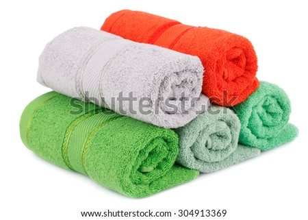 Rolled towels isolated on white background. - stock photo