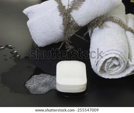 Rolled towels with soap/Towels and Soap/Rolled towels with burlap string and bar soap - stock photo