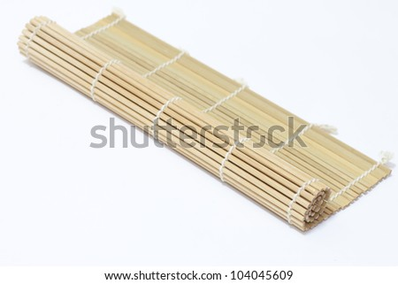 rolled up bamboo mat on isolated white