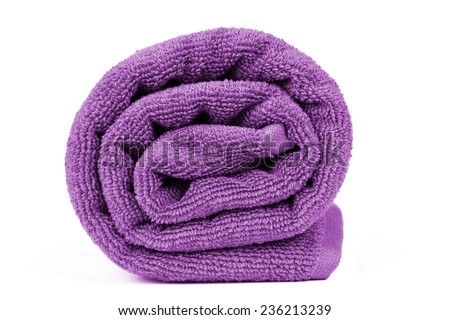 rolled up beach towel on white background - stock photo